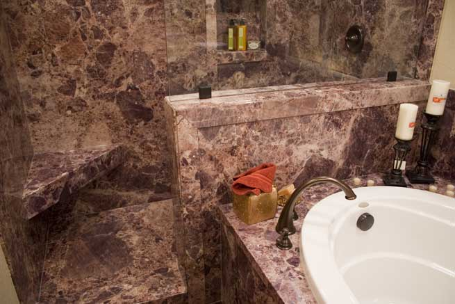 Benefits of Solid Synthetic Walls in Your Shower/Tub Area